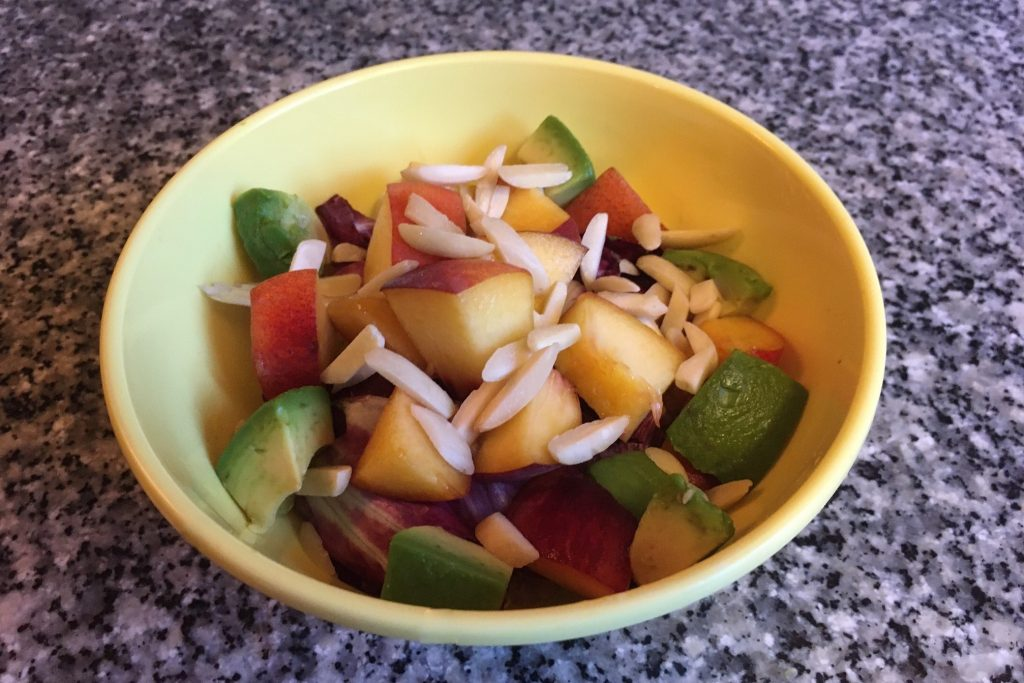 create your own grain bowl: quinoa with radicchio, avocados, peaches, and slivered almonds
