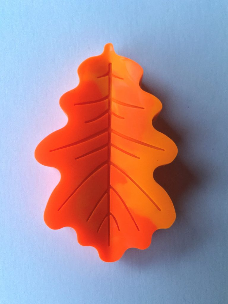 orange leaf-shaped crayon