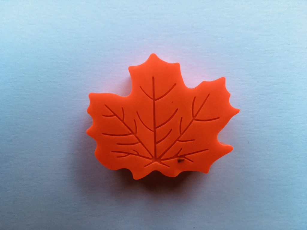red leaf-shaped crayon