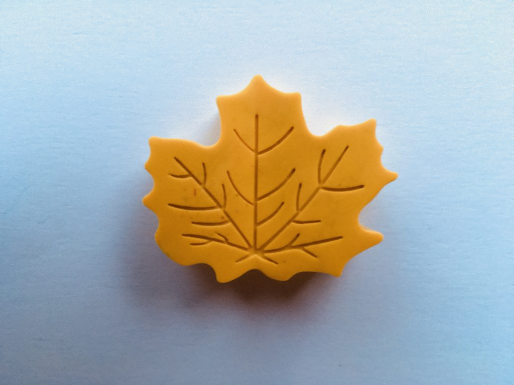 yellow leaf-shaped crayon