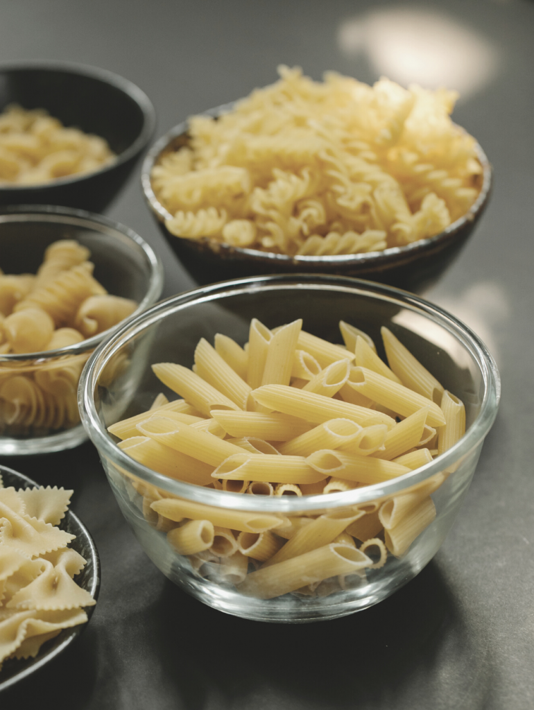 Bowls of uncooked pasta